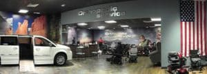 Orthopedic Service showroom with mobility van, scooters and power wheelchair