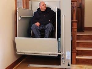 man using vertical wheelchair lift