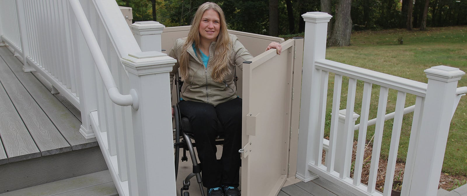woman on wheelchair getting out of residential platform lift