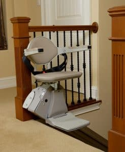 stair lift on top of stairs inside house