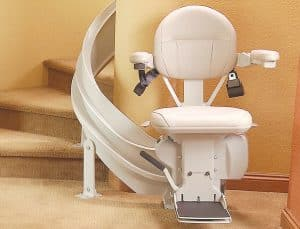 curved stair lift parked bottom of staircase