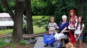 woman on outdoor stair lift with family
