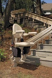 outdoor curved stair lift at bottom of stair