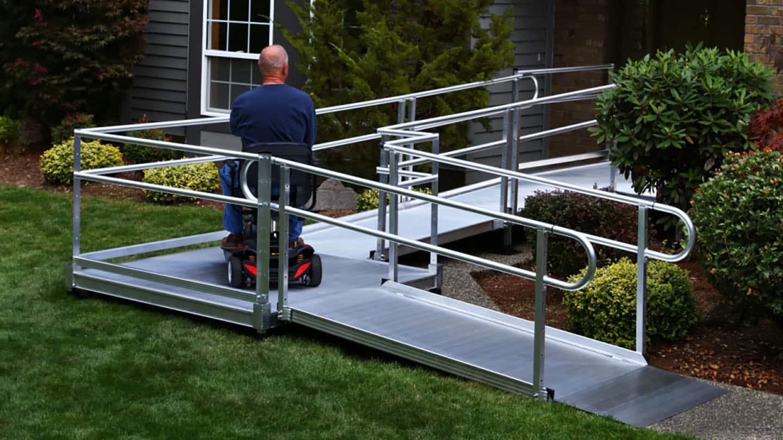 man on wheelchair using semi permanent ramp