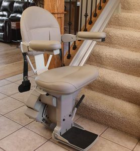 indoor stair lift unfolded at bottom of stairs