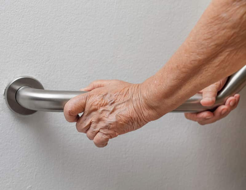 elderly hand grabbing a residential bar