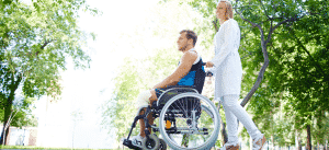 couple at park with man on wheelchair