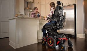 permobil power wheelchair couple at kitchen