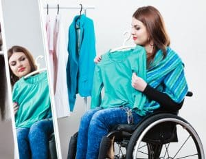 woman in wheelchair choosing clothes