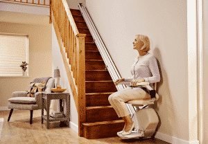 woman using stair lift looking upstairs
