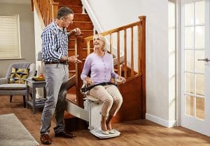 couple talking to each other while woman is in stair lift