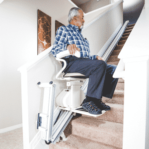 man using stair lift