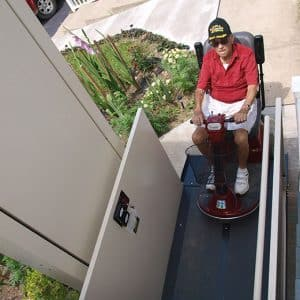 man on scooter using vertical platform lift