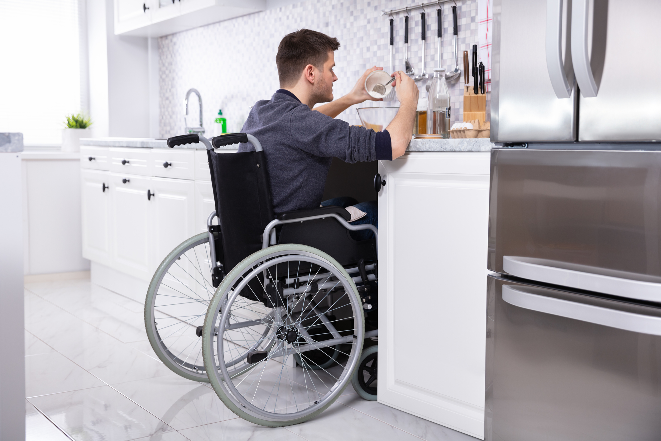 Disabled Man Preparing Food In Kitchen